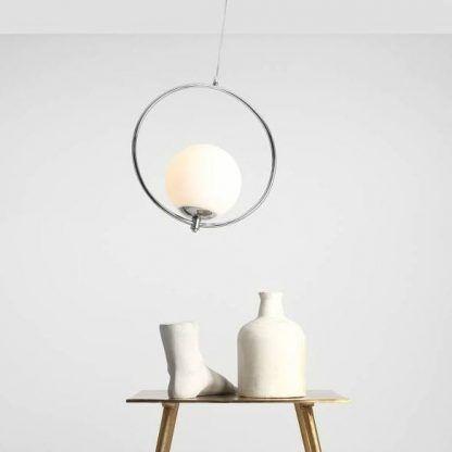 Lampa wisząca Sol nad stolik kawowy w salonie